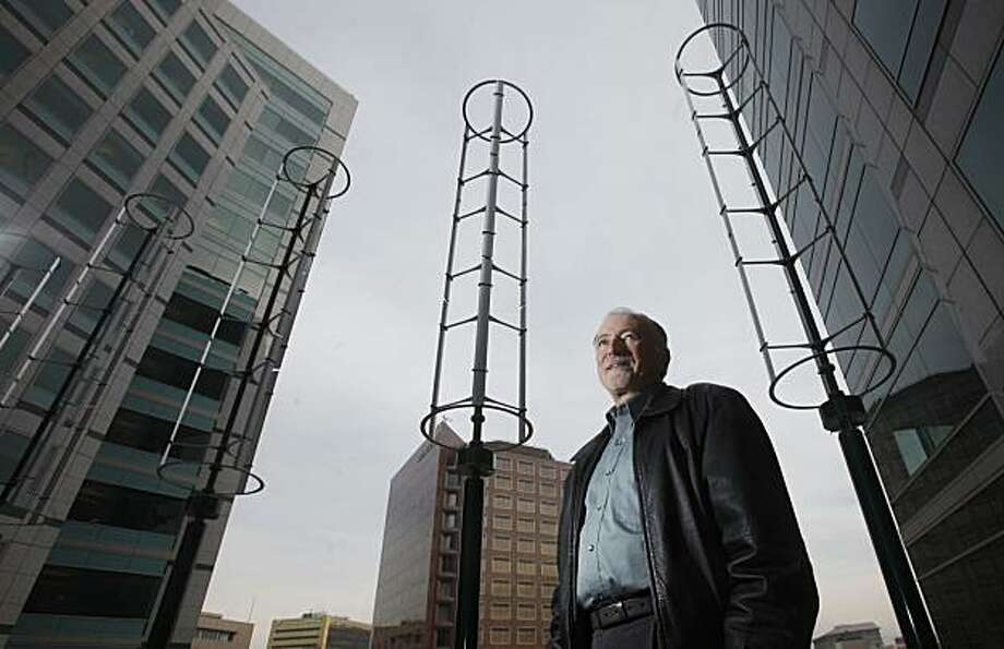 Randy Knox, Senior Dir. of Global Workplace Solutions at Adobe Systems, stands for a portrait in front of 20 newly installed wind turbines on the rooftop of their downtown campus on Monday January 11, 2010 in San Jose, Calif. The turbines, set to be fully operational by the end of this month, will help reduce the companies power usage and help save the company money in the near future. Photo: Mike Kepka, The Chronicle