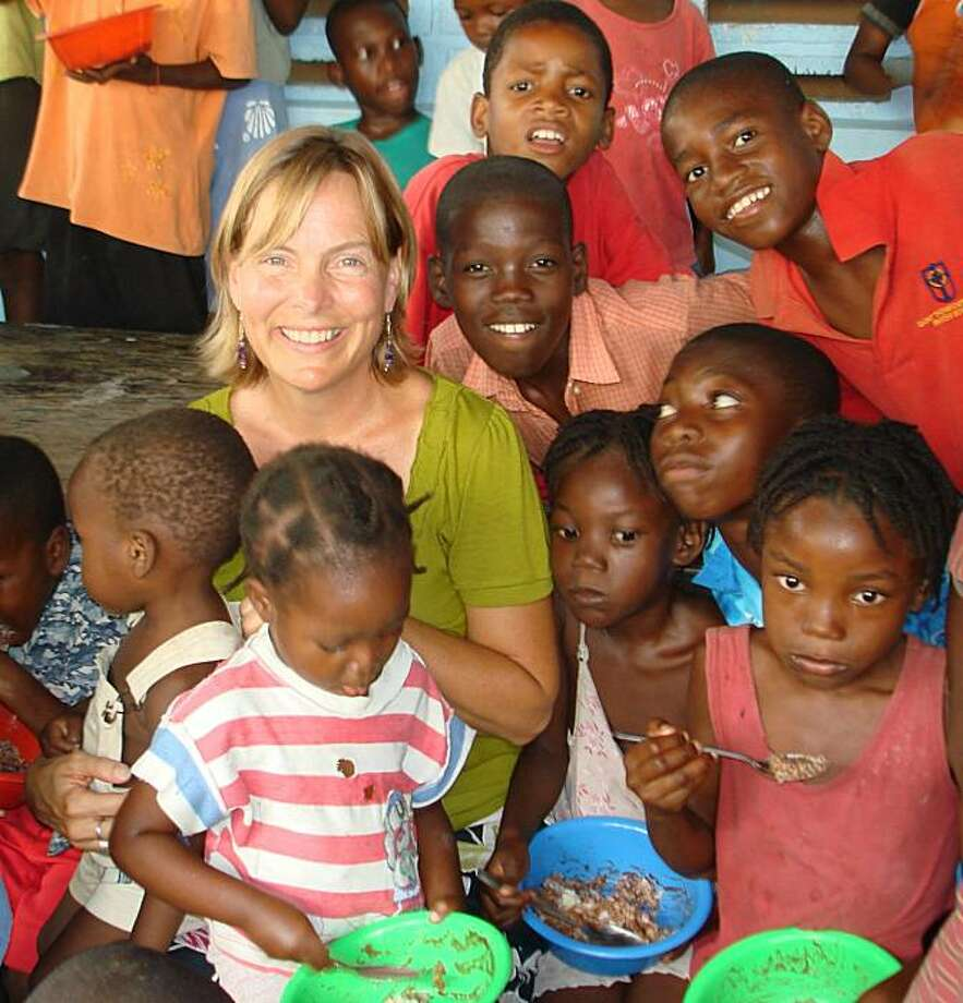 Margaret Trost with kids at haiti food program Founder and Director, What If? Foundation http://whatiffoundation.org/ Author of On That Day, Everybody Ate: One Woman's Story of Hope and Possibility in Haiti Photo: Margaret Trost, What If Foundation