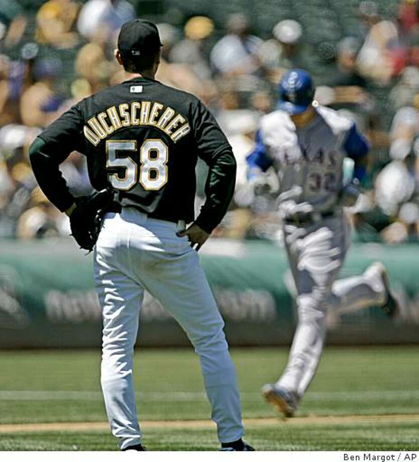 Oakland Athletics' Justin Duchscherer (58) waits for Texas Rangers ' Josh Hamilton, right, to run the bases after he hit a three-run home run in the fifth inning of a baseball game Saturday, July 26, 2008, in Oakland, Calif. (AP Photo/Ben Margot) Photo: Ben Margot, AP
