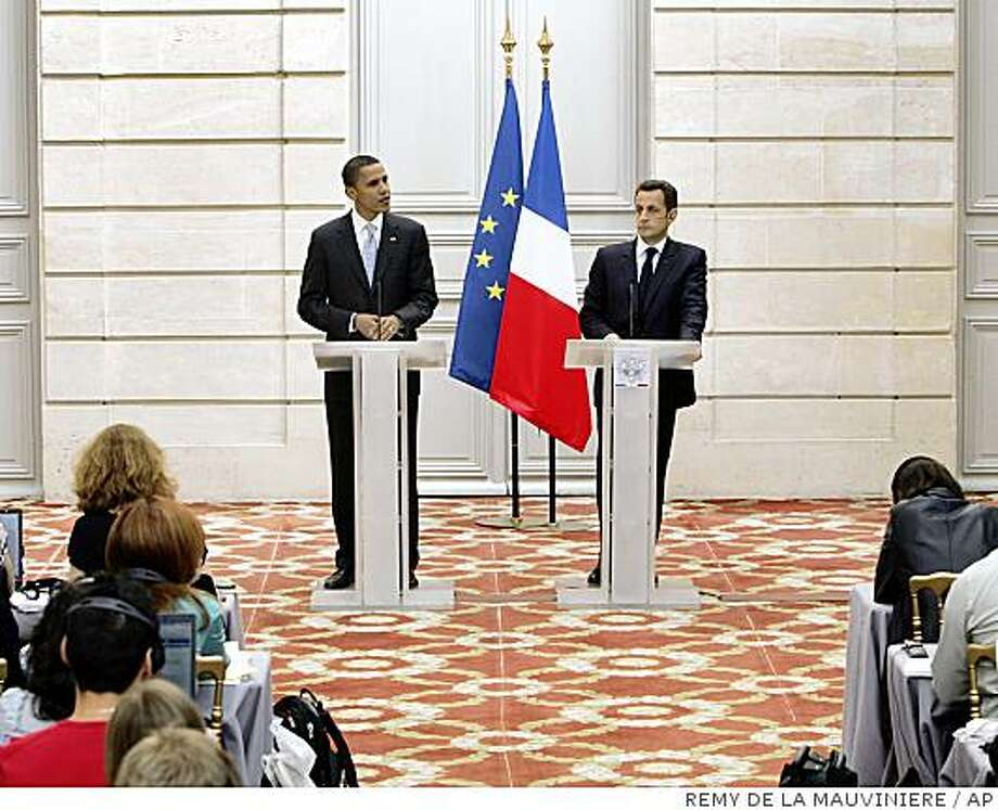 U.S. Democratic presidential contender Sen. Barack Obama, D-Ill., left, speaks as French President Nicolas Sarkozy, right, looks on, during a press conference following their meeting at the Elysee Palace, in Paris, Friday, July 25, 2008. (AP Photo/Remy de la Mauviniere) Photo: REMY DE LA MAUVINIERE, AP