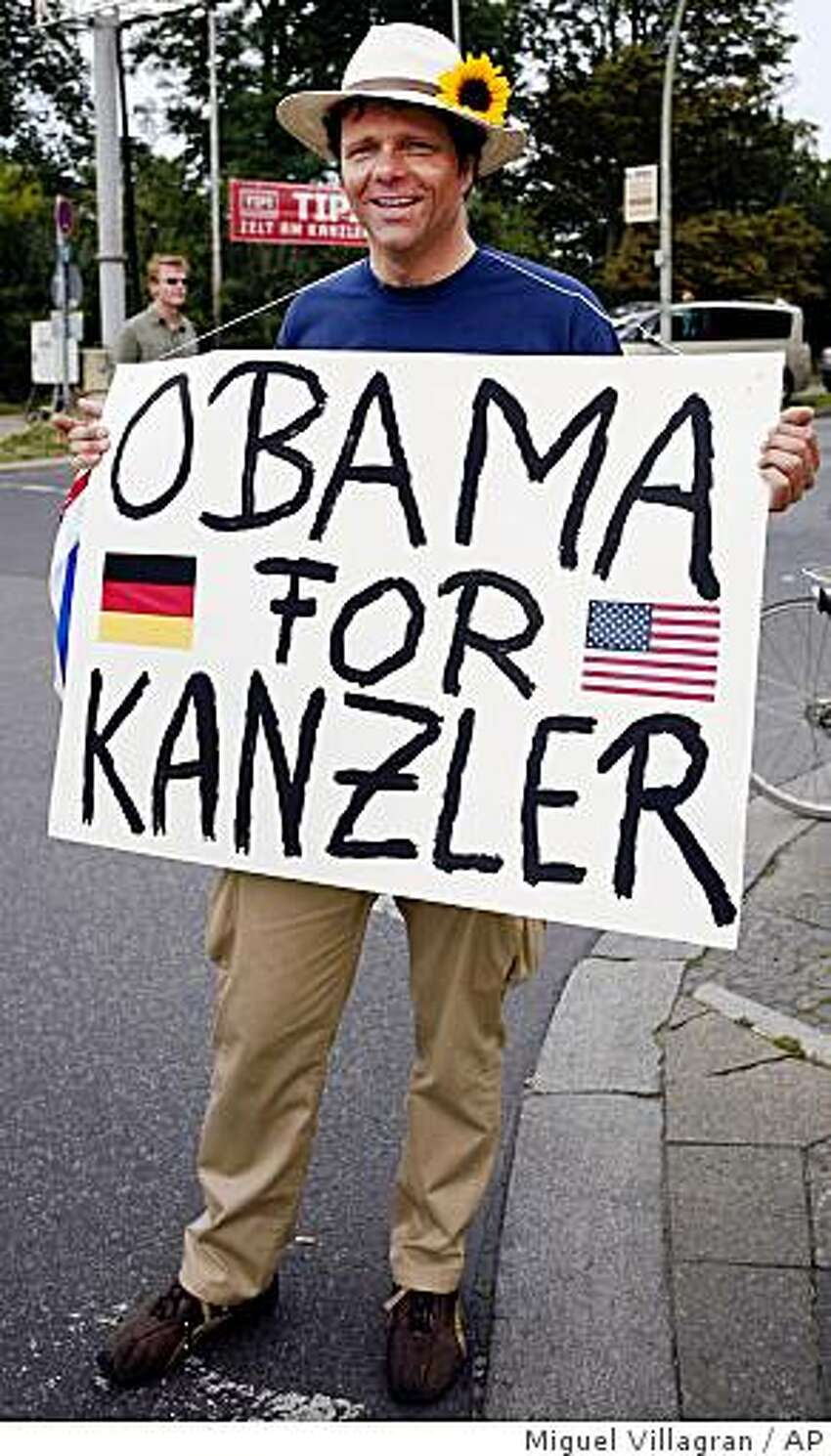 A supporter of U.S. Democratic presidential candidate Sen. Barack Obama, D-Ill., holds a poster meaning