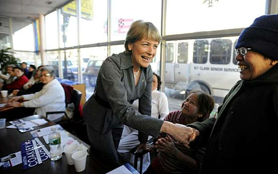 Candidate for the U.S. Senate seat left empty by the death of Sen. Edward M. Kennedy, D-Mass., Massachusetts Attorney General Democrat Martha Coakley shakes hands with Yen Tran, right, originally of Vietnam, now of Boston, Mass., while visiting a senior center in the Dorchester neighborhood of Boston, Wednesday, Jan. 13,  2010. Photo: Gretchen Ertl, AP