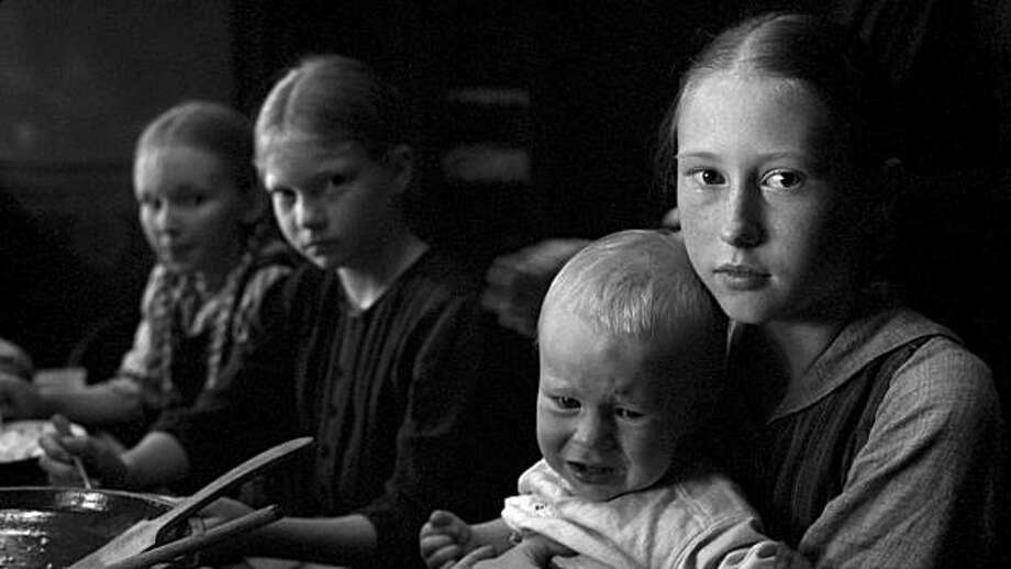 Left to Right: Kristina Kneppek as Else, Stephanie Amarell as Sophie, Bianca Mey as Paula, Mika Ahrens as Willi (the Farmer�s other children) in The White Ribbon. Photo: Films Du Losange, Courtesy Sony Pictures Classics