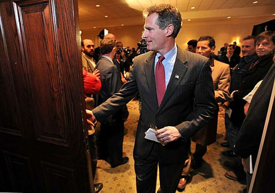 Republican senatorial candidate Scott Brown, center, leaves a press conference at the Omni Parker House in Boston, Thursday, Jan. 14, 2010, where he accepted the support of a group of veterans ahead of the special election to be held Tuesday, Jan 19, to fill the senate seat left vacant by the death of Sen. Ted Kennedy. Photo: Josh Reynolds, AP