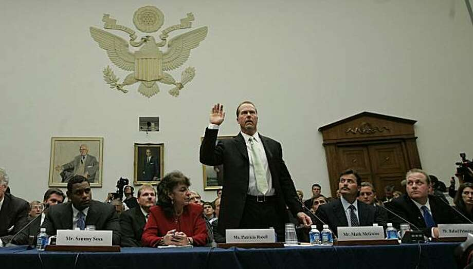 """*FILE PHOTO* -- Baseball player Mark McGwire is sworn in as Sammy Sosa, left, and Rafael Palmeiro and Curt Schilling, right, look on as they appear before House Government Reform Committee on steroids use in baseball on Capitol Hill, in 2005. Five years after famously dodging questions about steroids during a nationally televised congressional hearing, McGwire admitted on Monday to using them throughout his career. In a statement released by the St. Louis Cardinals, McGwire said that he began using steroids in the late 1980s and used them """"on occasion throughout the 1990s,"""" including the 1998 season, when McGwire captivated the nation by hitting 70 home runs to break the all-time single season record of 61 held by Roger Maris. (Doug Mills/The New York Times) Photo: Doug Mills, NYT"""