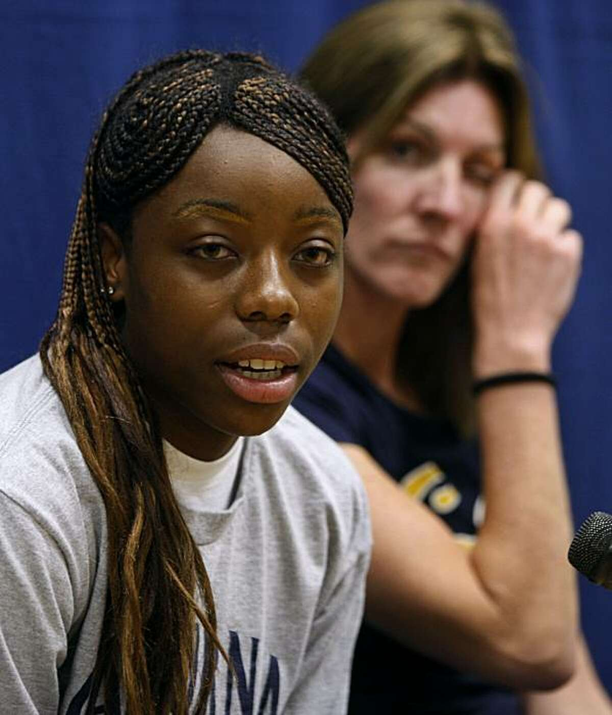 Cal Bears freshman basketball player Tierra Rogers, with head coach Joanne Boyle (right) by her side, talks about her future with the team after falling ill and being diagnosed with a heart condition, ending her career, in Berkeley, Calif., on Friday, Oct. 9, 2009.
