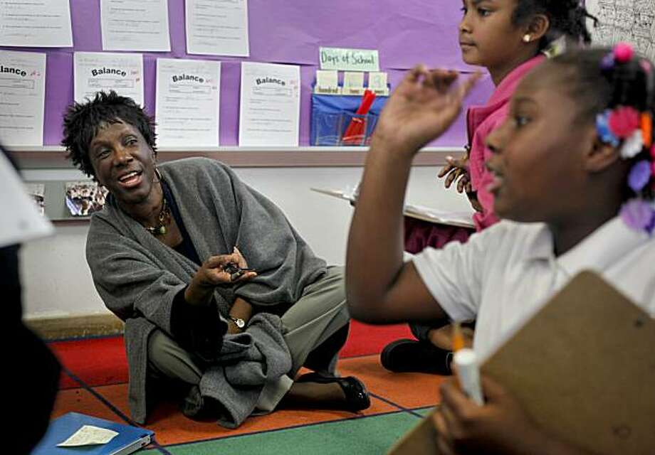 "Imani Cooley, on Thursday January 7, 2010, visting 2nd graders, Imani Howell, (right) and Jada Woodsen, (center), Cooley is in her first year as principal of Macolm X Academy Elementary School in Hunters Point, San Francisco, Calif. She shares her thoughts about the ""Race to The Top""  education program, which aims to turn around schools but principals like her have their own ideas of what it takes. Photo: Michael Macor, The Chronicle"