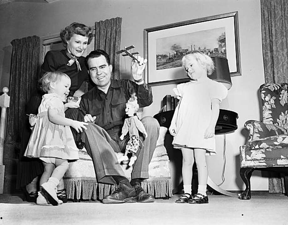 """In this image by photographer Oliver """"Ollie"""" Atkins, released by the National Archives on Monday, Jan. 11, 2010, Sen. and Mrs. Nixon play with their young daughters Julie. left, and Tricia at home. The Richard Nixon Presidential Library and Museum opened approximately 280,000 pages of textual materials, 12 hours of sound recordings and 7,000 images from the personal collection of White House photographer Atkins. (AP Photo/National Archives, Oliver Atkins) Senator and Mrs. Nixon playing with their young daughters Julie and Tricia at home Photo: Oliver F. Atkins, AP"""