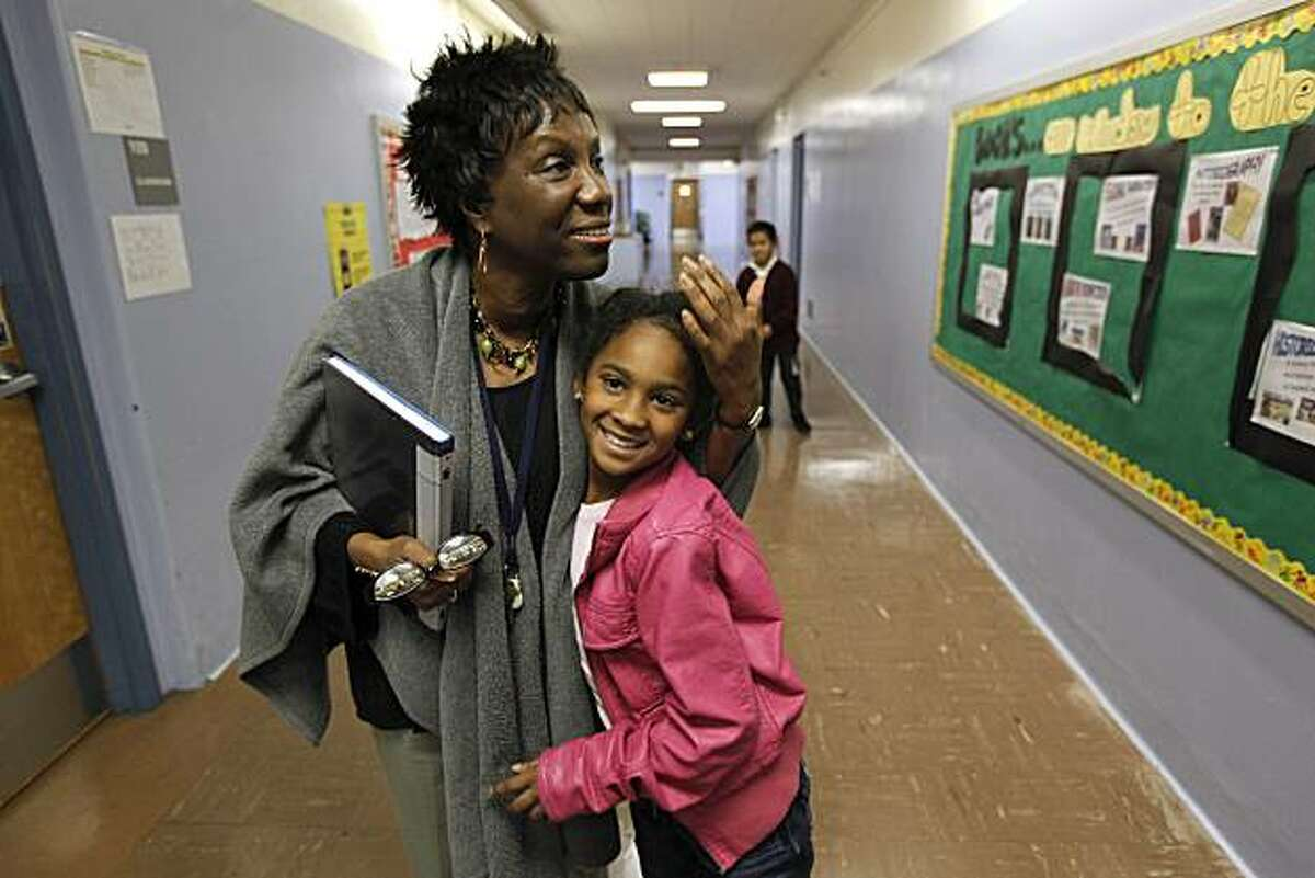 """Imani Cooley, on Thursday January 7, 2010, hugs 2nd grader Jada Woodson in the hallway of her school, Cooley is in her first year as principal of Macolm X Academy Elementary School in Hunters Point, San Francisco, Calif. She shares her thoughts about the """"Race to The Top"""" education program, which aims to turn around schools but principals like her have their own ideas of what it takes."""