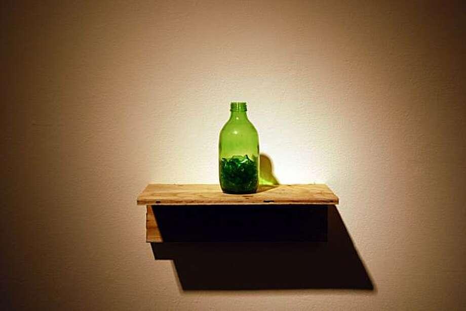 """Untitled (two glass bottles)"" (2009) glass and wood by Pablo Guardiola Photo: Raquel De Anda, Galeria De La Raza"