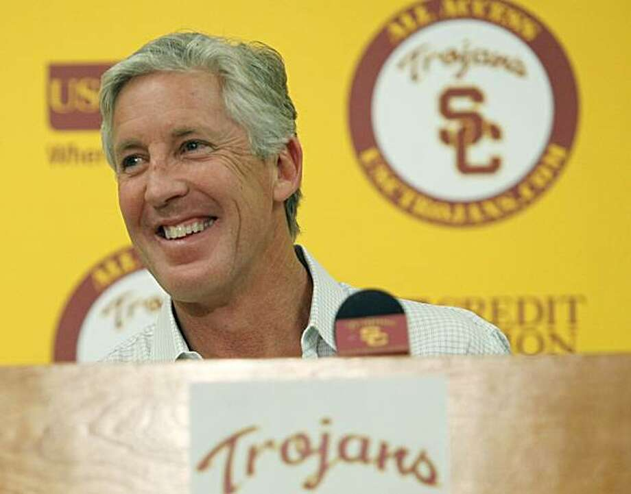 University of Southern California football coach Pete Carroll comments on his leaving to become coach of the Seattle Seahawks during a news conference at the USC campus in Los Angeles on Monday, Jan 11, 2010.   Carroll says the only reason he is leaving Southern California to become Seattle Seahawks coach is because the challenge was too good to pass up. Photo: Damian Dovarganes, AP