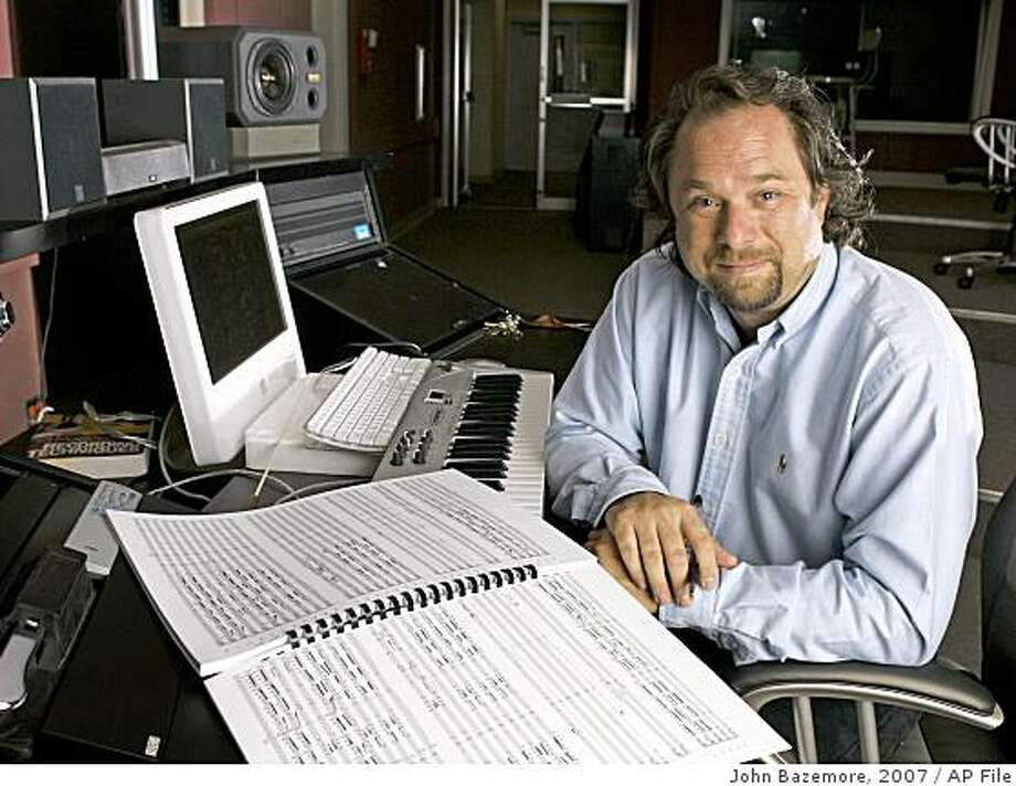**FILE** In this June 13, 2007 file photo, Composer Lee Johnson poses in the music department at LaGrange College in LaGrange, Ga. Johnson, a classical music composer-conductor,  has constructed an entire symphony from selected Grateful Dead songs and recorded it with the Russian National Orchestra. (AP Photo/John Bazemore, file) Photo: John Bazemore, 2007, AP File