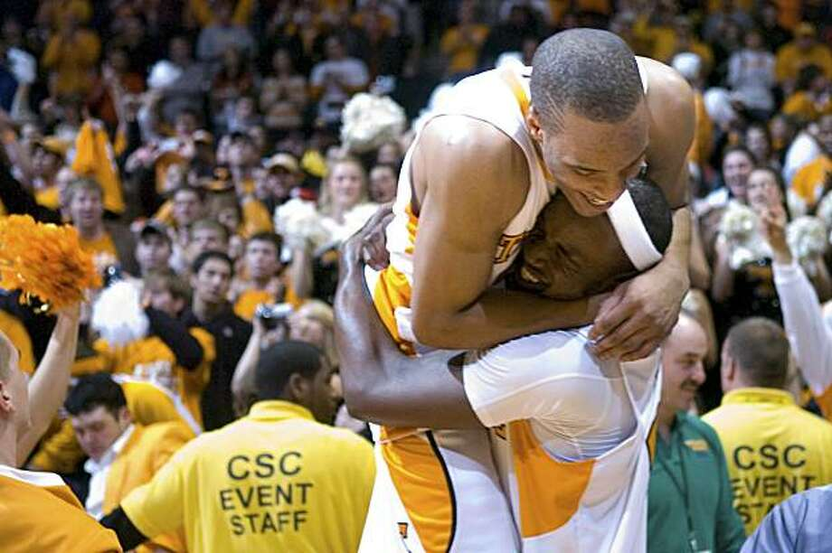 Tennessee's J.P. Prince, top, and Wayne Chism celebrate Tennessee's 76-68 win over Kansas in an NCAA college basketball game at Thompson-Boling Arena on Sunday, Jan. 10, 2010, in Knoxville, Tenn. Photo: Saul Young, AP