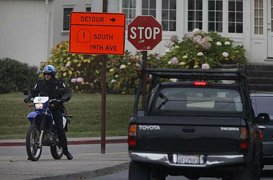 After the 19th Avenue off ramp from North bound Doyle drive was closed, a motorcycle officer with the United States Park Police waits to control redirected traffic headed towards 19th Avenue on January 11, 2010 in San Francisco, Calif. Photo: Mike Kepka, The Chronicle