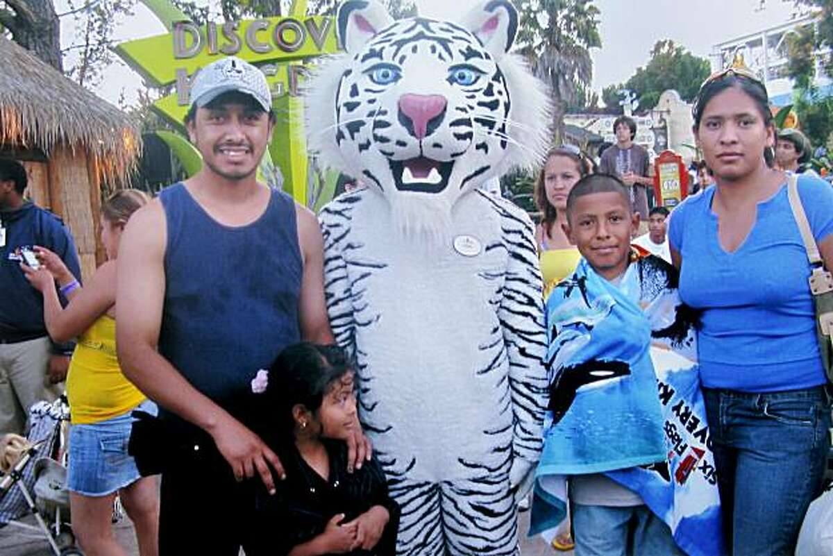 A recent photo of the Ayala family at a theme park shows the slain father, left.