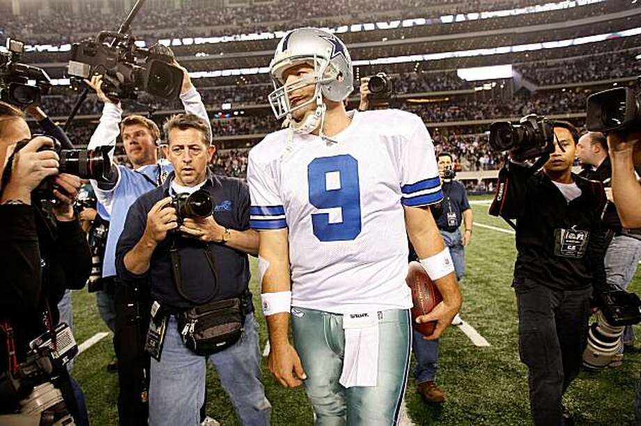 ARLINGTON, TX - JANUARY 09:  Quarterback Tony Romo #9 of the Dallas Cowboys celebrates a 34-14 win against the Philadelphia Eagles during the 2010 NFC wild-card playoff game at Cowboys Stadium on January 9, 2010 in Arlington, Texas. Photo: Ronald Martinez, Getty Images