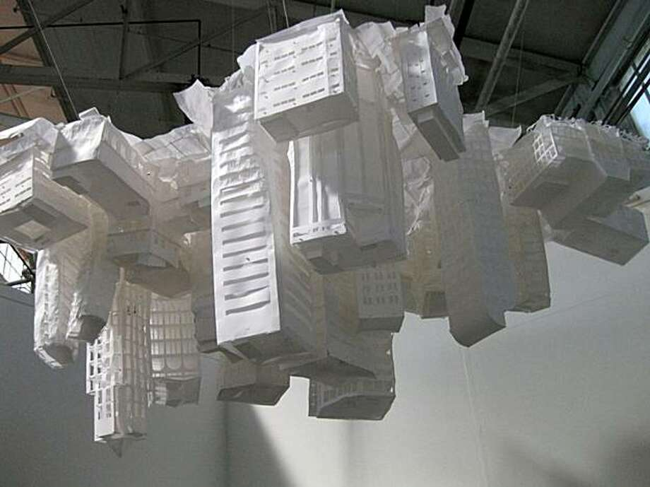 "Claire Jackel's installation of paper skyscrapers suspended in space invites meditation on the destructibility of all things in ""Gravity Always Wins."" Photo: The Lab"
