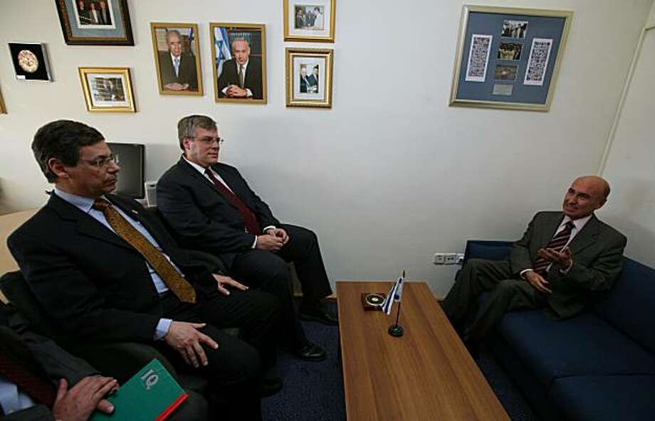 In this Monday, Jan. 11, 2010 photo, Israel's Deputy Foreign Minister, Danny Ayalon, left, meets with Turkish ambassador to Israel Ahmet Oguz Celikkol, right, in Jerusalem. Ayalon summoned the Turkish ambassador to criticize a Turkish television drama depicting Israeli security forces as kidnapping children and shooting old men. At the start of the meeting, Ayalon told cameramen the ambassador was pointedly seated on a sofa lower than his own chair. He also noted there was no Turkish flag on display. Alsoseen in the picture, center, is Naor Gilon, a Foreign Ministry official. Photo: Gil Yohanan, AP