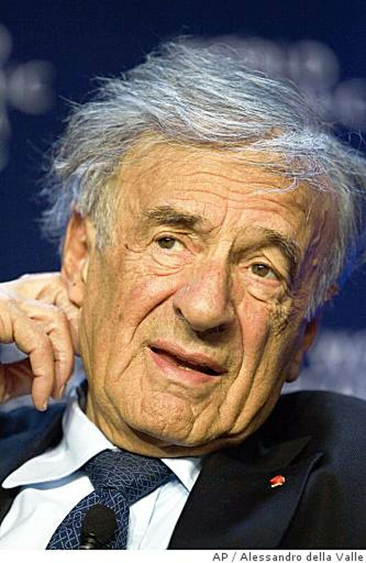 ** FILE ** In this Sunday Jan. 27, 2008 picture, Boston University Professor Elie Wiesel prepares for the final plenary session of the Annual Meeting of the World Economic Forum, WEF, in Davos, Switzerland. The Holocaust survivor and scholar told jurors in San Francisco Tuesday, July 8, 2008 that he was shocked to learn the man accused of accosting him was linked to a movement that denies millions of Jews were killed during World War II. (AP Photo/Keystone, Alessandro della Valle)
