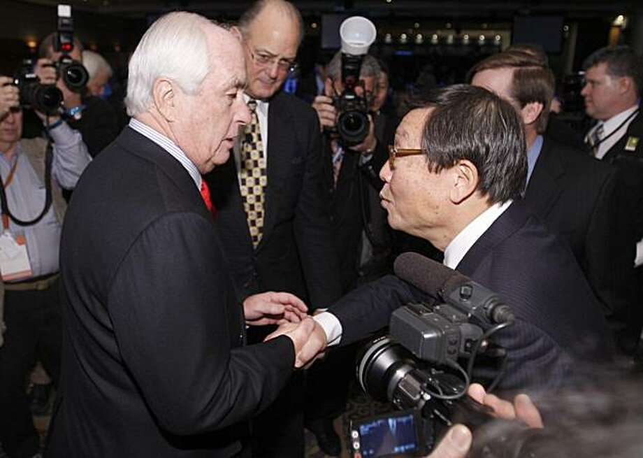 Businessman Roger Penske, left, greets Chairman of Toyota Motors Sales Yoshi Inada at the North American International Auto Show Monday, Jan. 11, 2010, in Detroit. Photo: Carlos Osorio, AP