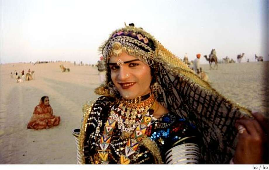 "Harish, of the group Maharaja. who performs the ""knee dance"" in female costume in ""Gypsy Caravan."" Photo: Ho"