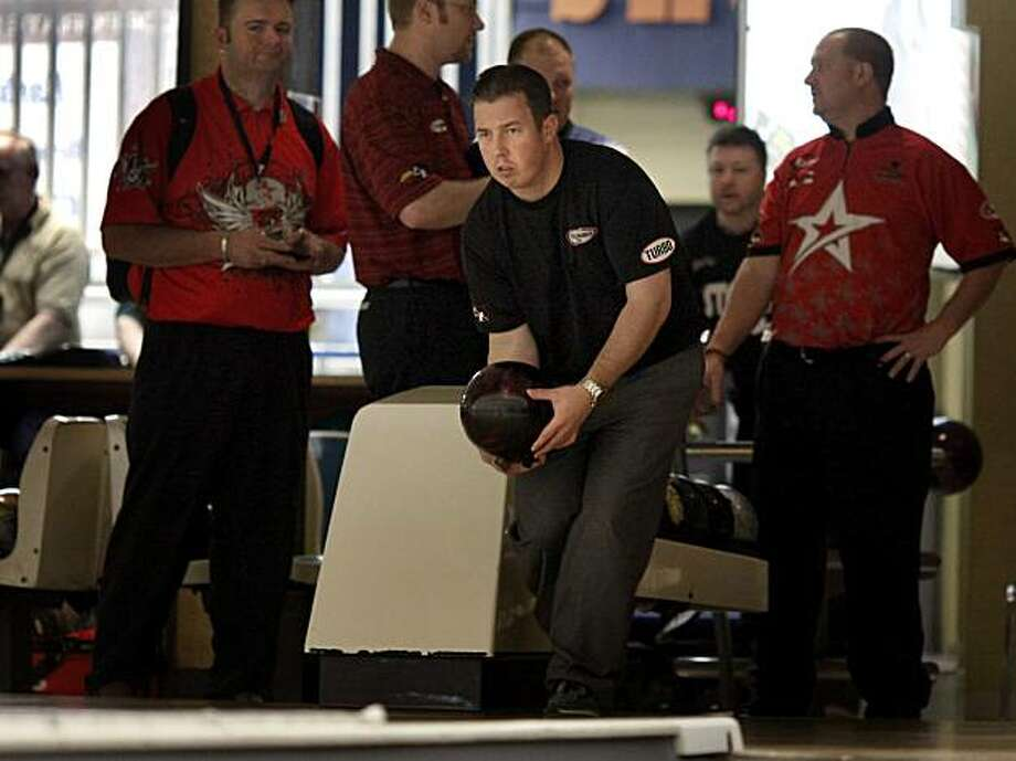 Smallwood (center) concentrates during his practice round.Professional bowler Tom Smallwood, who lost his job as a Detroit autoworker, is finding fame and fortune on the PBA tour.  There is a tournament in Dublin, CA this weekend. Photo: Brant Ward, The Chronicle