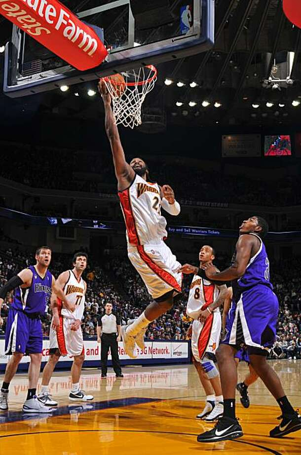 OAKLAND, CA - JANUARY 8: Ronny Turiaf #21 of the Golden State Warriors takes it strong to the basket against the Sacramento Kings on January 8, 2010 at Oracle Arena in Oakland, California. NOTE TO USER: User expressly acknowledges and agrees that, by downloading and or using this photograph, user is consenting to the terms and conditions of Getty Images License Agreement. Mandatory Copyright Notice: Copyright 2010 NBAE (Photo by Rocky Widner/NBAE via Getty Images) Photo: Rocky Widner, NBAE/Getty Images