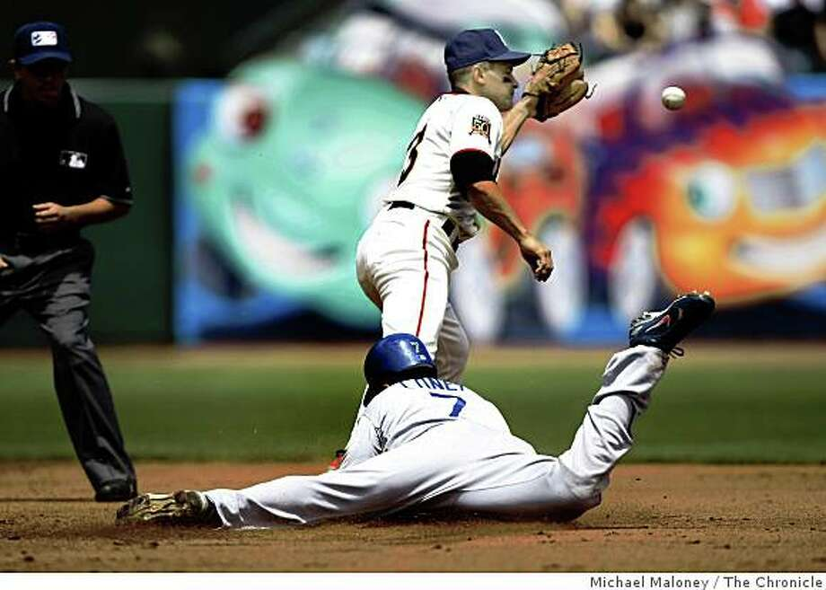 Los Angeles Dodgers James Loney slides safely into 2nd base on a double during a MLB game between the San Francisco Giants and the Los Angeles Dodgers at AT&T Park in San Francisco, Calif., on July 4, 2008. San Francisco Giants Omar Vizquel covering.Photo by Michael Maloney / The Chronicle Photo: Michael Maloney, The Chronicle
