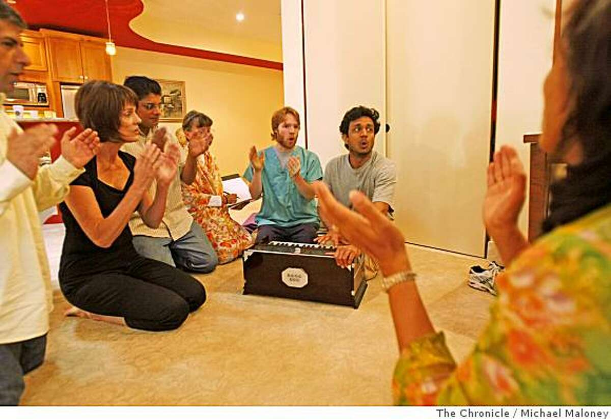 Director and playwright Sujit Saraf, seated, second from right leads members of Naatak in song during rehearsal of their next play, Mataji in the basement of a member's home in Palo Alto, Calif., on July 13, 2008.. Naatak is a group of Indian Theater enthusiasts, made up of San Francisco Bay Area residents. This amateur group was originally formed by students at Stanford University and the University of California, Berkeley.