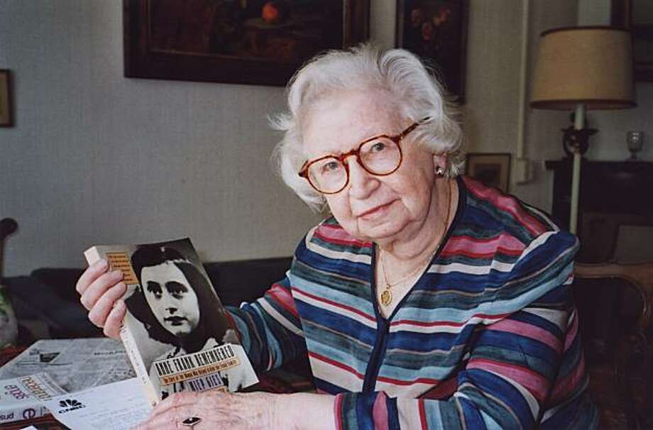 "FILE - In this 1998 photo Miep Gies displays a copy of her book ""Anne Frank Remembered"" at her apartment in Amsterdam, Netherlands. Anne Frank called them the Helpers. They provided food, books and good cheer while her family hid for two years from the Nazis in a tiny attic apartment. On Sunday, Feb. 15, 2009, the last surviving helper, Miep Gies, celebrates her 100th birthday, saying she has won more accolades for helping the Frank family than she deserved as if, she says, she tried to save all the Jewsof occupied Holland. The Anne Frank Museum says Gies, who helped the teenage diarist's family hide from the Nazis, died Monday Jan. 11, 2010. She was 100. Photo: Steve North, AP"