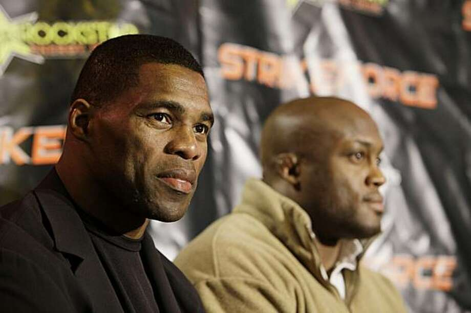 Former NFL player and Heisman Trophy winner Herschel Walker, left, and Bobby Lashley discuss their upcoming MMA matches during a Strikeforce news conference in Miami Lakes, Fla. Tuesday, Jan. 12, 2010. The former running back holds a fifth-degree black belt in Tae Kwon Do. Photo: J Pat Carter, AP