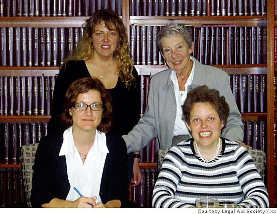 Lisa Craib, seated at right, is autistic and worked at McDonald's in Berkeley for 20 years. She has sued, claiming the franchise's new owner fired her because of her disability. Also in this picture are Craib's mother, Karola Craib, standing at right; her sister, Anne Craib, standing at left; and Legal Aid Society attorney Claudia Center, seated at left. The only one we care about for story purposes is Lisa Craib. Photo: Xx, Courtesy Legal Aid Society