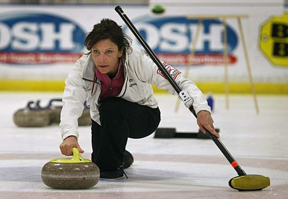 Karen Officer throws a rock towards the target on a curling sheet in San Jose, Calif., on Tuesday, Nov. 17, 2009. Photo: Paul Chinn, The Chronicle