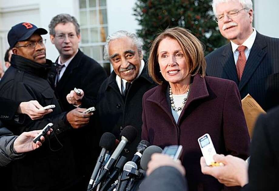WASHINGTON - JANUARY 06:  U.S. Speaker of the House Rep. Nancy Pelosi (D-CA) speaks to the media as Rep. Charles Rangel (D-NY) (L) and Rep. George Miller (D-CA) (R) listen after a meeting with President Barack Obama at the White House January 6, 2010 in Washington, DC. The House Democratic Leaders met with the President to discuss the Health Care Reform Bill. Photo: Alex Wong, Getty Images