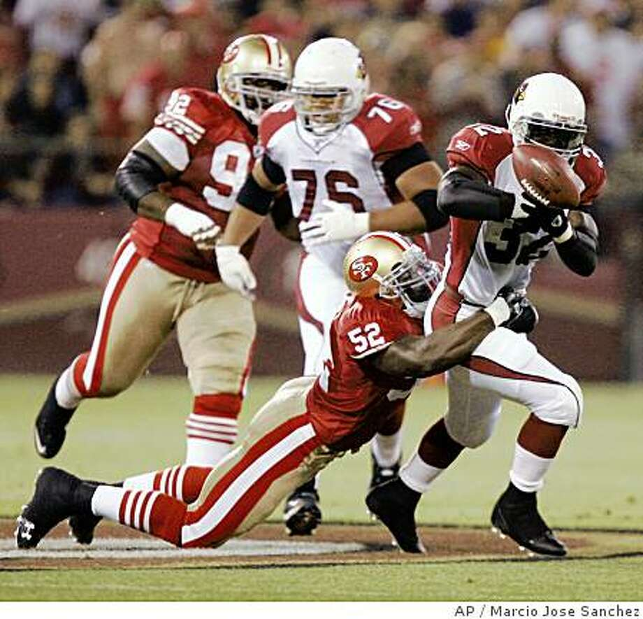 ** FILE ** Arizona Cardinals running back Edgerrin James, right, loses the ball while he is tackled by San Francisco 49ers linebacker Patrick Willis during the first half of an NFL football game in San Francisco, in this Sept. 10, 2007 file photo. Willis won The Associated Press 2007 NFL Defensive Rookie of the Year award Friday Jan. 4, 2008.  (AP Photo/Marcio Jose Sanchez) Photo: Marcio Jose Sanchez, AP