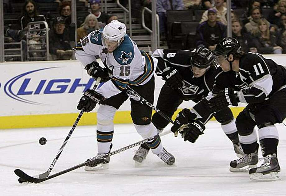 San Jose Sharks left wing Dany Heatley,  left, shoots as he is defended by Los Angeles Kings center Anze Kopitar, right, of Slovenia, and Drew Doughty during the first period of an NHL hockey game in Los Angeles, Monday, Jan. 11, 2010. Photo: Jae C. Hong, AP