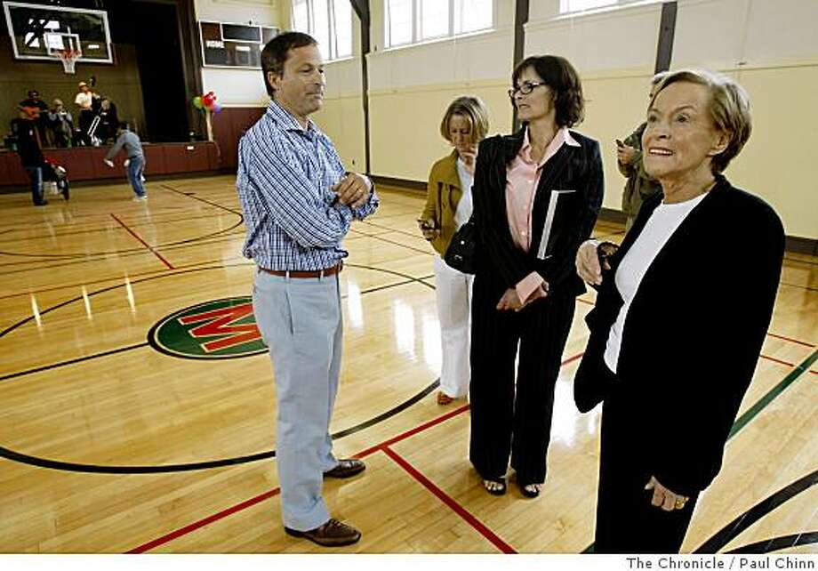 Gina Moscone, right, widow of former Mayor George Moscone, looks at the newly-renovated  Moscone Recreation Center with her son Christopher and daughters Rebecca and Jennifer in San Francisco, Calif., on Saturday, July 19, 2008. The historic building, named in honor of her husband who was assassinated in 1978, reopened after an $8 million restoration project.Photo by Paul Chinn / The Chronicle Photo: Paul Chinn, The Chronicle