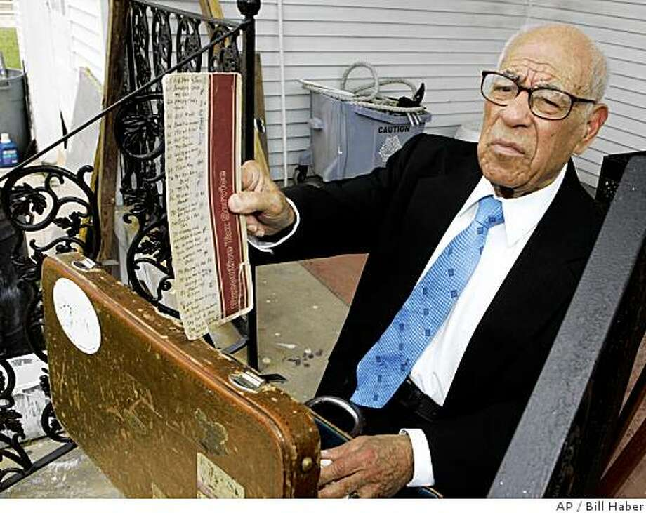 New Orleans jazz trumpeter Lionel Ferbos shows a music sheet after posing  for a photograph in front of his home that was damaged by Hurricane Katrina Thursday, July 17, 2008 in New Orleans. Ferbos is the oldest actively working jazz musician in New Orleans. He performs with his band at the Palm Court Jazz Cafe in the French Quarter on Saturdays. (AP Photo/Bill Haber) Photo: Bill Haber, AP