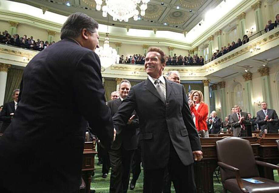 Gov. Arnold Schwarzenegger shakes hands with former Assembly Speaker Robert Hertzberg, D-Los Angeles, as he walks to the podium to deliver his final State of the State address before a joint session of the Legislature at the Capitol in Sacramento on Wednesday. Photo: Rich Pedroncelli, AP