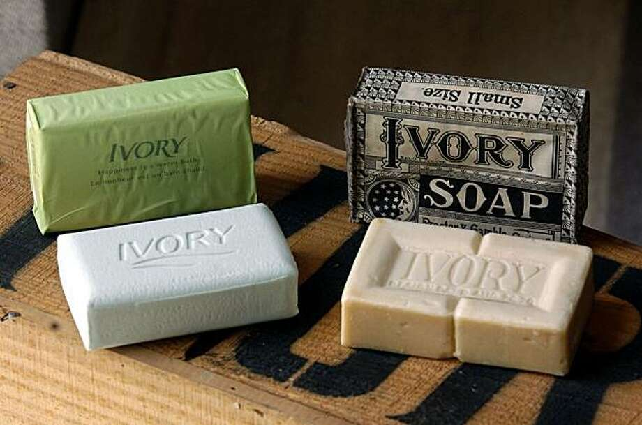** FOR RELEASE AT 12:01 A.M. EST  ** An original bar of Ivory soap and one in it's original wrapper, right, sits on a shipping crate inside the Archives Center at the Procter & Gamble headquarters Friday, June 18, 2004, in Cincinnati, next to the latest offering from the company, a new green bar of Ivory bar that also floats. (AP Photo/David Kohl) Photo: David Kohl, AP