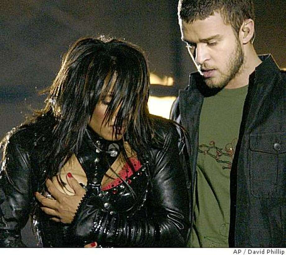 "**FILE** In a Sunday Feb. 1, 2004 file photo, entertainer Janet Jackson, left, covers her breast after her outfit came undone during the half time performance with Justin Timberlake  at Super Bowl XXXVIII  in Houston. A federal appeals court in Philadelphia threw out out a $550,000 fine issued by the Federal Communications Commission against CBS Corp. Monday, July 21, 2008, for the 2004 Super Bowl halftime show that ended with Janet Jackson's breast-baring ""wardrobe malfunction.""(AP Photo/David Phillip, File) Photo: David Phillip, AP"