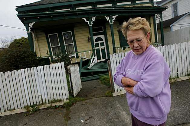 Connie Beattie looks over the damage of a house on California Street in Eureka on Sunday. The home collapsed off of its foundation during Saturday's 6.5 earthquake. Photo: Lacy Atkins, The Chronicle