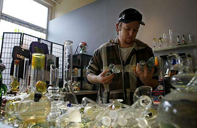 Jesse Mitchell picks up damaged bongs Sunday at the Humboldt Glass Blowers in Eureka. Photo: Lacy Atkins, The Chronicle