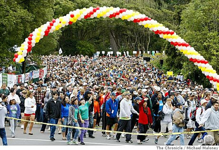 Twenty-five thousand participants start out under the balloon banner at Sharon Meadow in Golden Gate Park. They raised over $4.5 million in the 22nd annual AIDS Walk in San Francisco, Calif., on July 20, 2008. Since 1987, AIDS Walk San Francisco has raised over $55 million for HIV programs and services in the Bay Area.Photo by Michael Maloney / The Chronicle Photo: Michael Maloney, The Chronicle