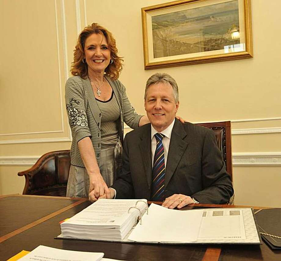 FILE - A June 5, 2008 photo from files of Iris Robinson, with her husband, Northern Ireland First Minister Peter Robinson. First Minister Peter Robinson vowed Friday, Jan. 8, 2010 he wouldn't quit as leader of Northern Ireland's Catholic-Protestant government following revelations that his wife, Iris _ like him a British Parliament member _ solicited 50,000 pounds ($80,000) from businessmen to launch a riverside cafe for her young boyfriend. Photo: John Harrison, AP