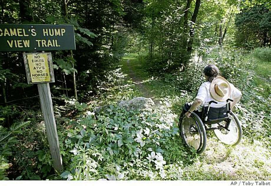 ** FOR IMMEDIATE RELEASE **Deborah Lisi-Baker starts her wheelchair up the View Trail at Camel's Hump in Duxbury, Vt., Thursday, July 26, 2007. The Camel's Hump View Trail is part of a nationwide push in the past 20 years to make more of the great outdoors accessible to people with disabilities. (AP Photo/Toby Talbot) Photo: Toby Talbot, AP