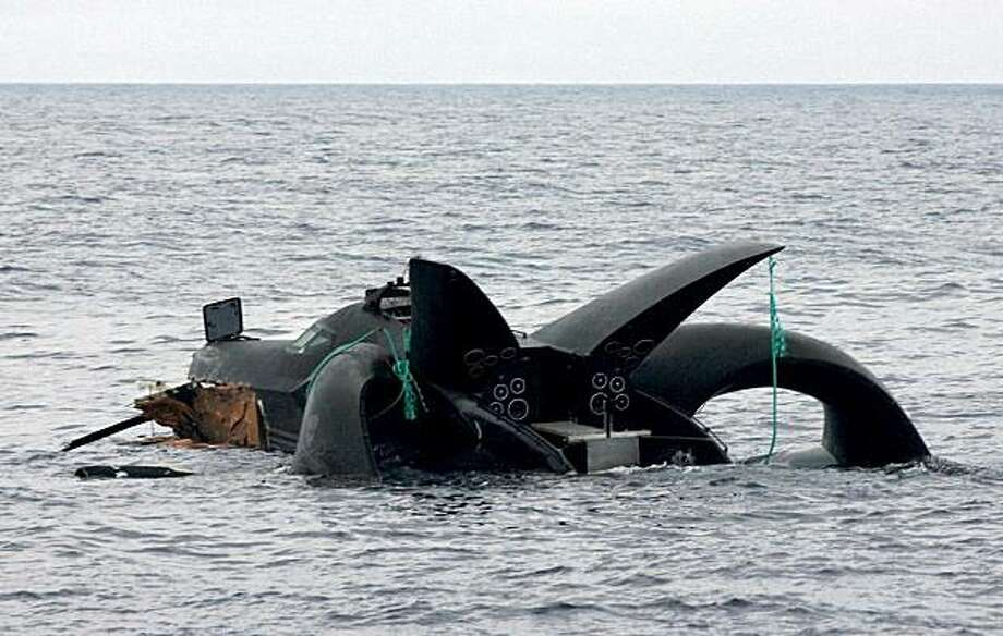 This handout photo released on January 8, 2010 from the Sea Shepherd Conservation Society shows the Sea Shepherd's hi-tech trimaran 'Ady Gil' sinking in the Southern Ocean off Antarctica after it was badly damaged in a collision with Japanese harpoon vessel 'Shonan Maru No 2'. Defiant anti-whaling activists on January 8 vowed to fight on after their high-tech superboat sank in Antarctic seas following a collision with a Japanese ship. Footage of the incident showed the Japanese whaler ploughing on January6 across the New Zealand-registered Ady Gil's bow and firing water cannon while its crew dived for safety. TOPSHOTS  RESTRICTED TO EDITORIAL USE Photo: Glenn Lockitch, AFP/Getty Images
