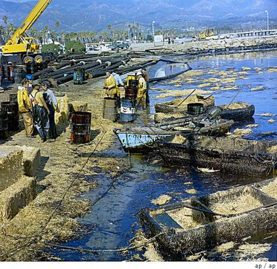 Workmen using pitchforks and shovels attempt to clean up oil-soaked straw from the beach at Santa Barbara Harbor, Calif. Feb. 7, 1969 after oil leaking from an off-shore well for over a week covered local beaches. (AP Photo) Photo: Ap