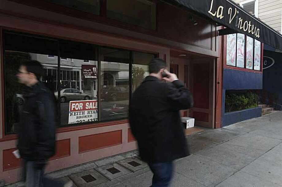 An empty store front at the corner of Octavia and Union Streets, formerly run as a restaurant, is just one of many casualties of a tough economy in the Cow Hollow neighborhood on Thursday Jan. 7, 2009 in San Francisco, Calif. Photo: Mike Kepka, The Chronicle