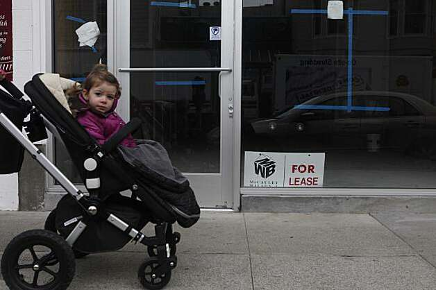 Pushed by her nanny, Olivia Mardera, 2, cruises past one of many empty store fronts at the corner of Octavia and Union Streets on Thursday Jan. 7, 2009 in San Francisco, Calif. Photo: Mike Kepka, The Chronicle